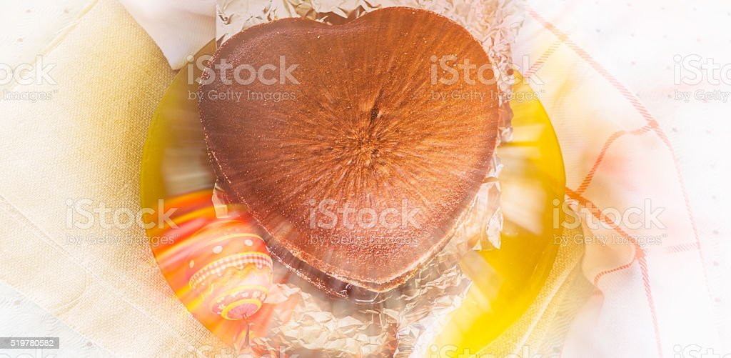 Sponge cake and Easter egg with blur effect and rays stock photo