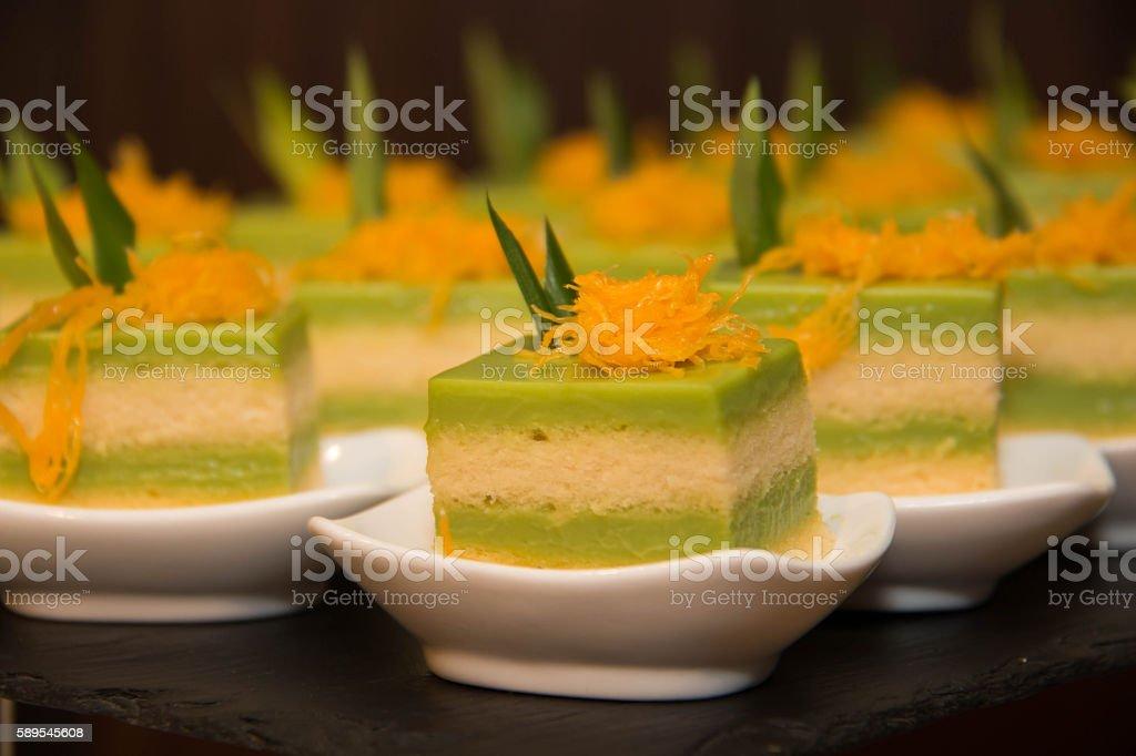 Sponge Cake Layered in Rich Pandan Kaya stock photo