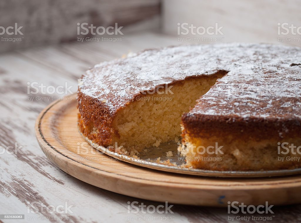 Sponge cake of lemon over wooden background stock photo