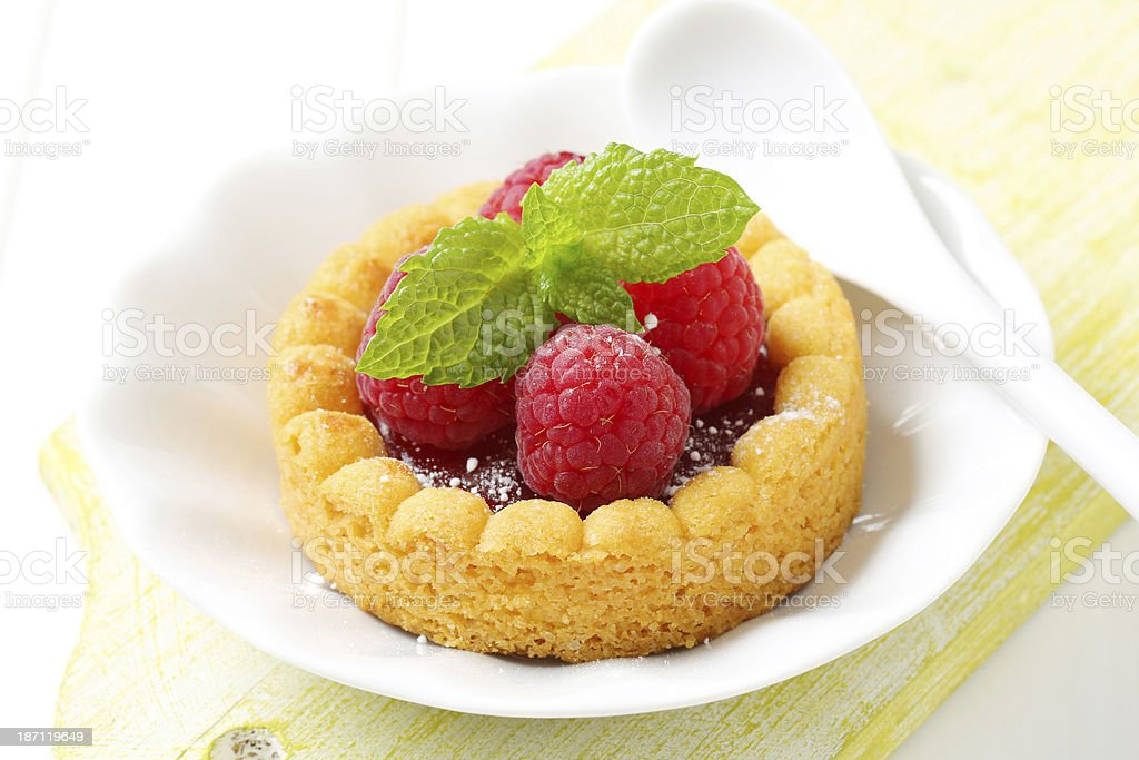sponge cake with jam and raspberries royalty-free stock photo