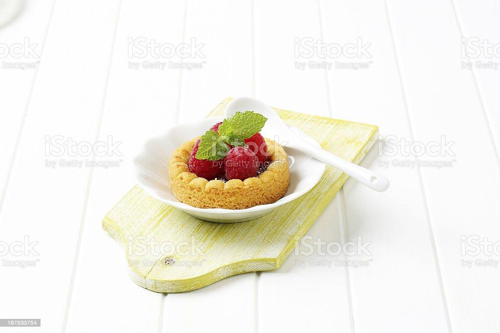 sponge cake with jam and raspberries royalty-free stock photo