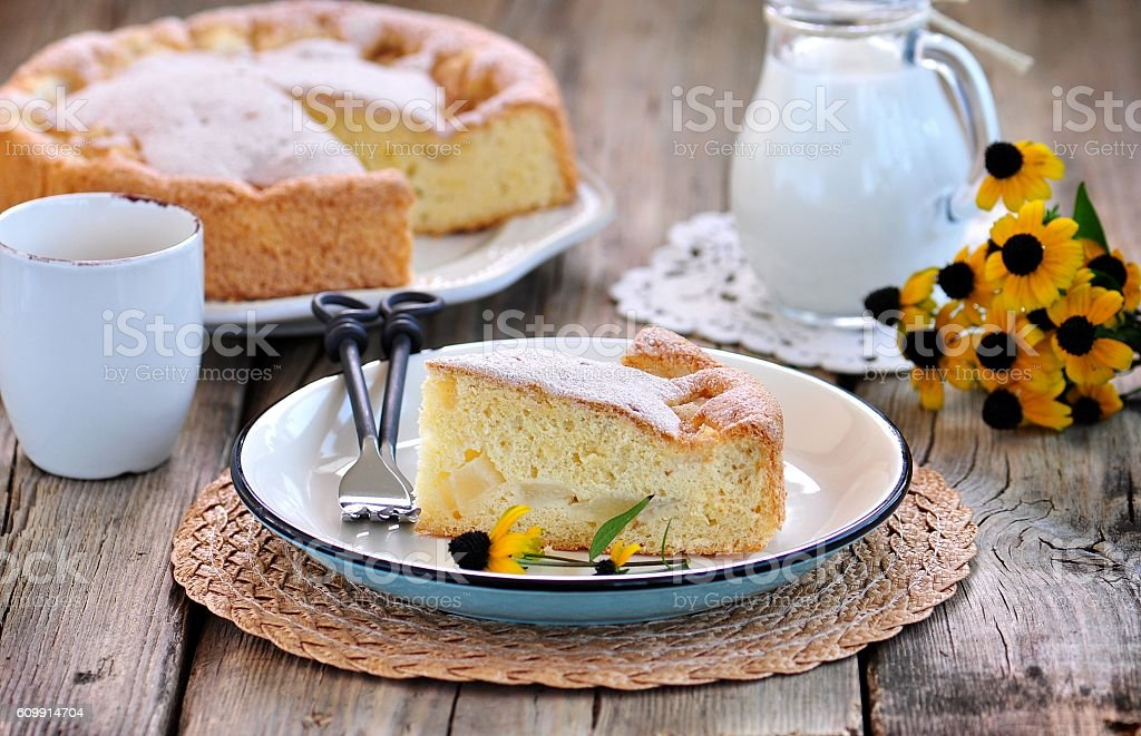 Sponge cake with melon on old wooden background. stock photo