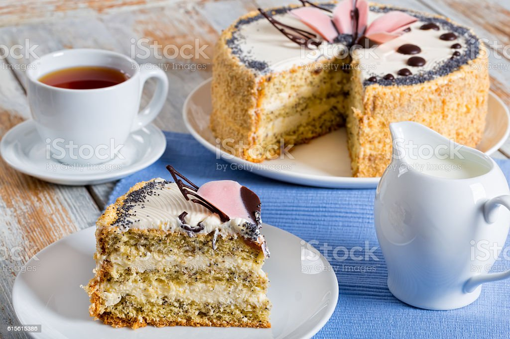 sponge cake with poppy seeds with a cut out piece stock photo