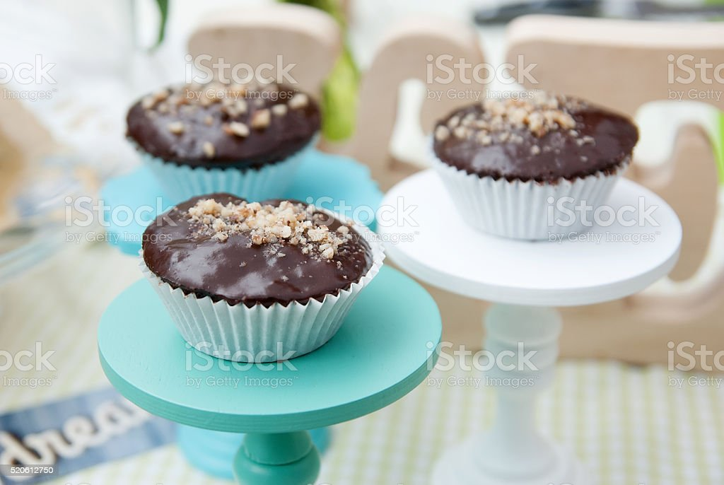 spongecake or muffin with chocolate sauce stock photo
