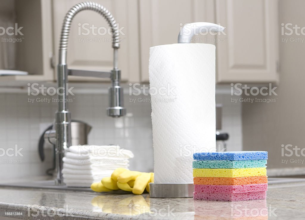 sponges, gloves, paper towels in modern kitchen for housework royalty-free stock photo