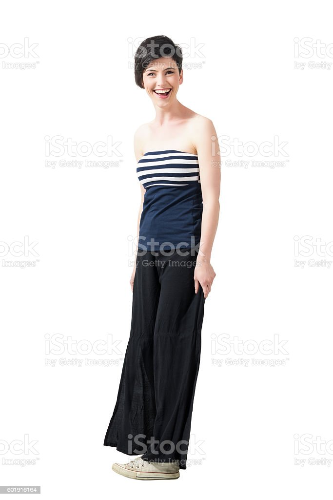 Spontaneously laughing short hair pretty woman looking at camera stock photo
