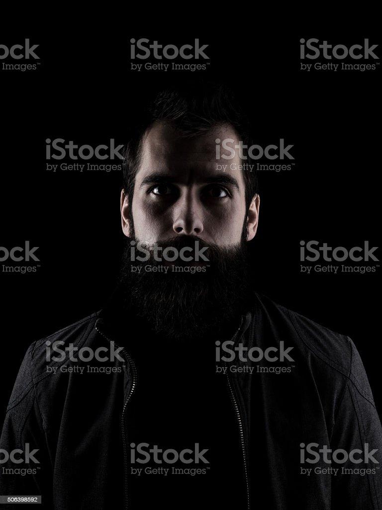 Spooky bearded man staring at camera stock photo