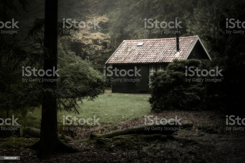 Spooky cabin in the woods stock photo