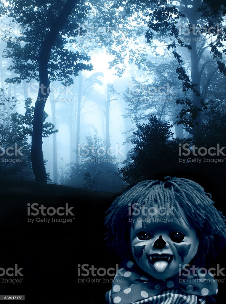 Spooky clown in the dark foggy forest stock photo
