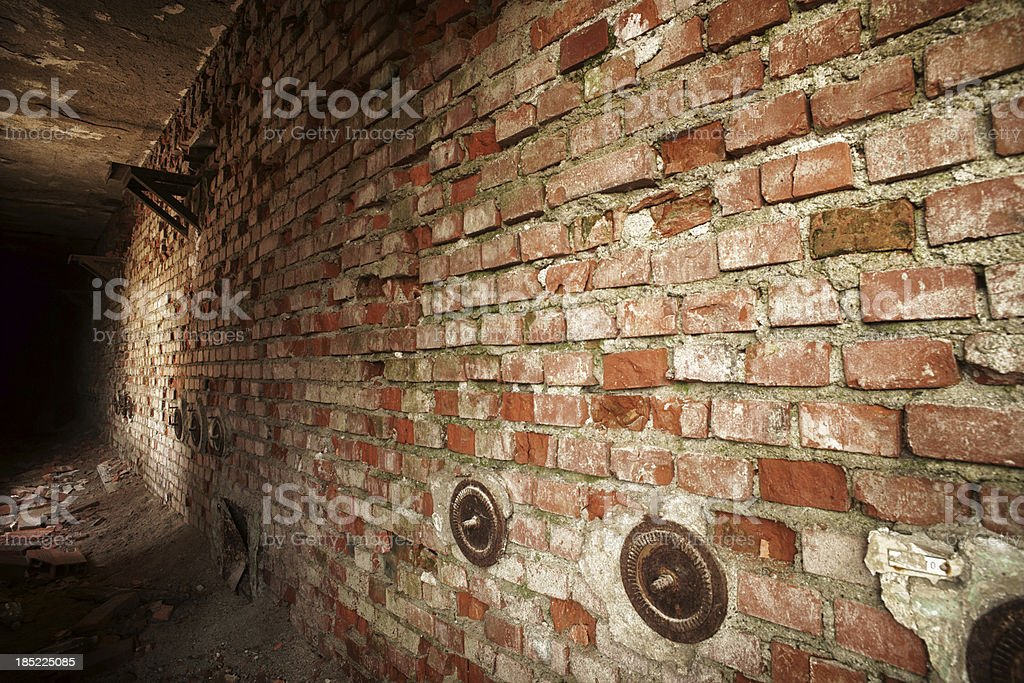 Spooky corridor ending in darkness royalty-free stock photo