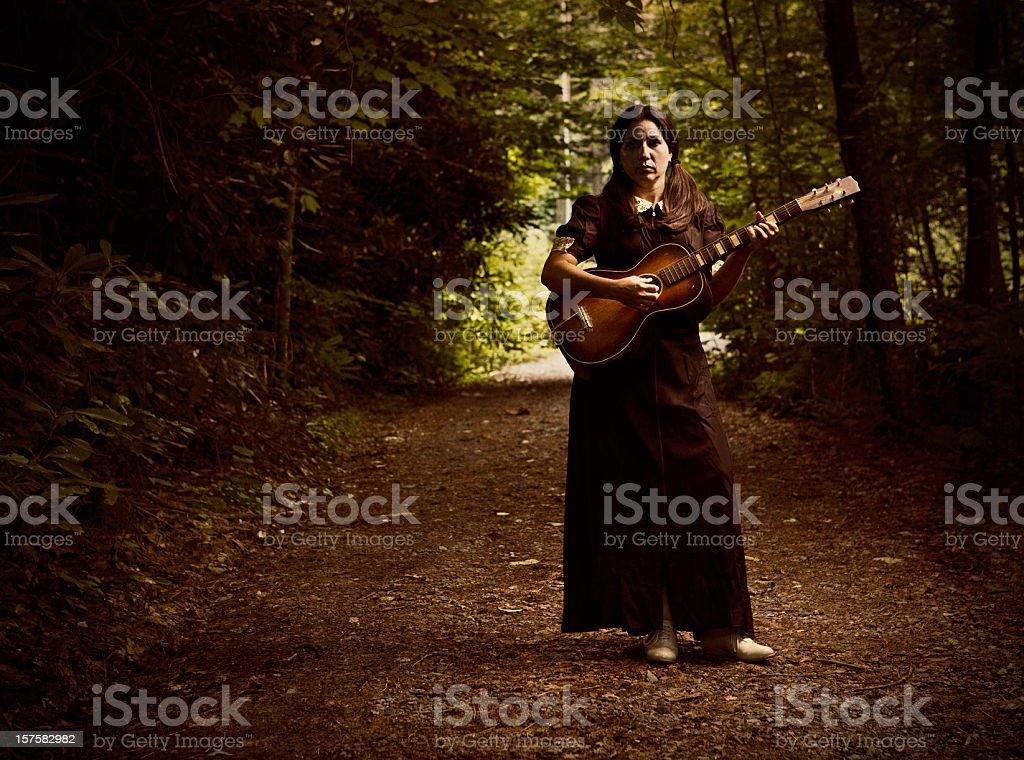 spooky country musician stock photo
