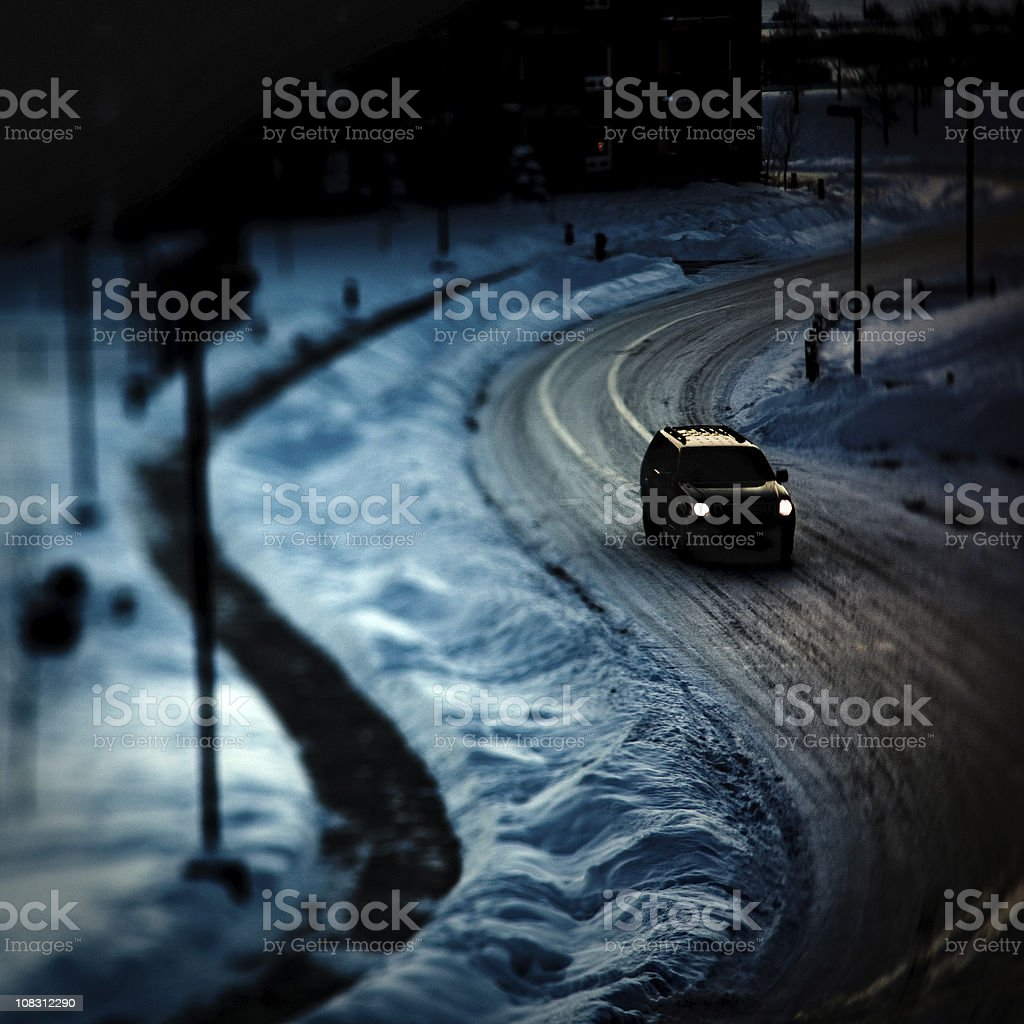 spooky dark SUV winter scene stock photo