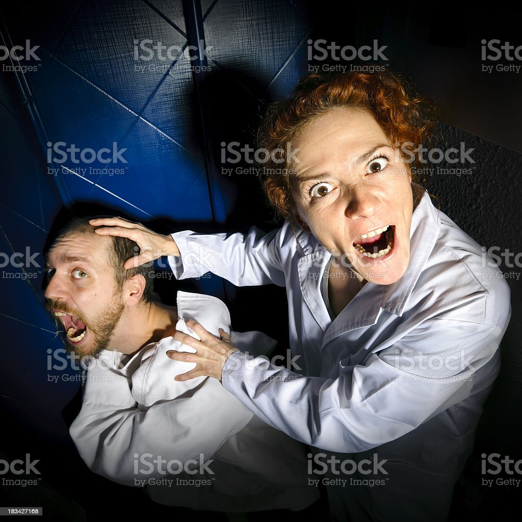 Spooky doctor and patient shouting royalty-free stock photo