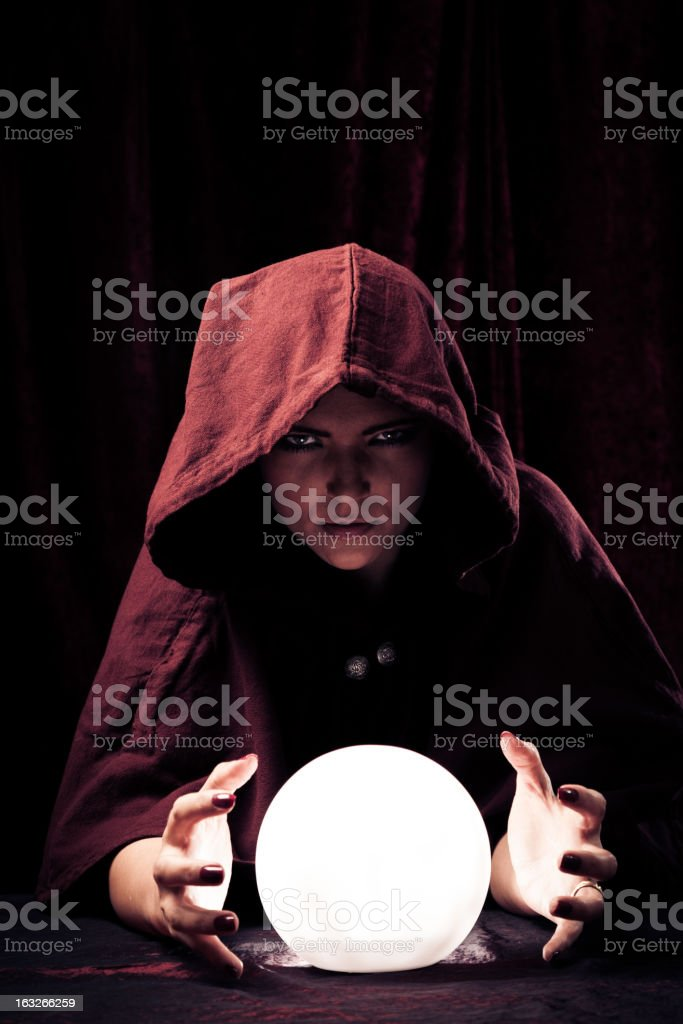 spooky fortune teller with crystal ball stock photo