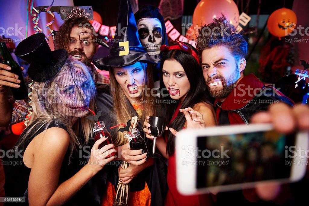 Spooky friends posing on the selfie stock photo