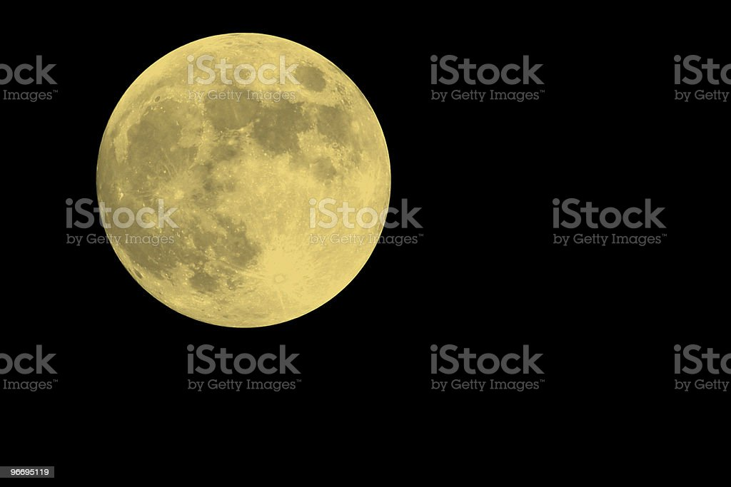 Spooky full moon shines brightly against the dark, October sky royalty-free stock photo