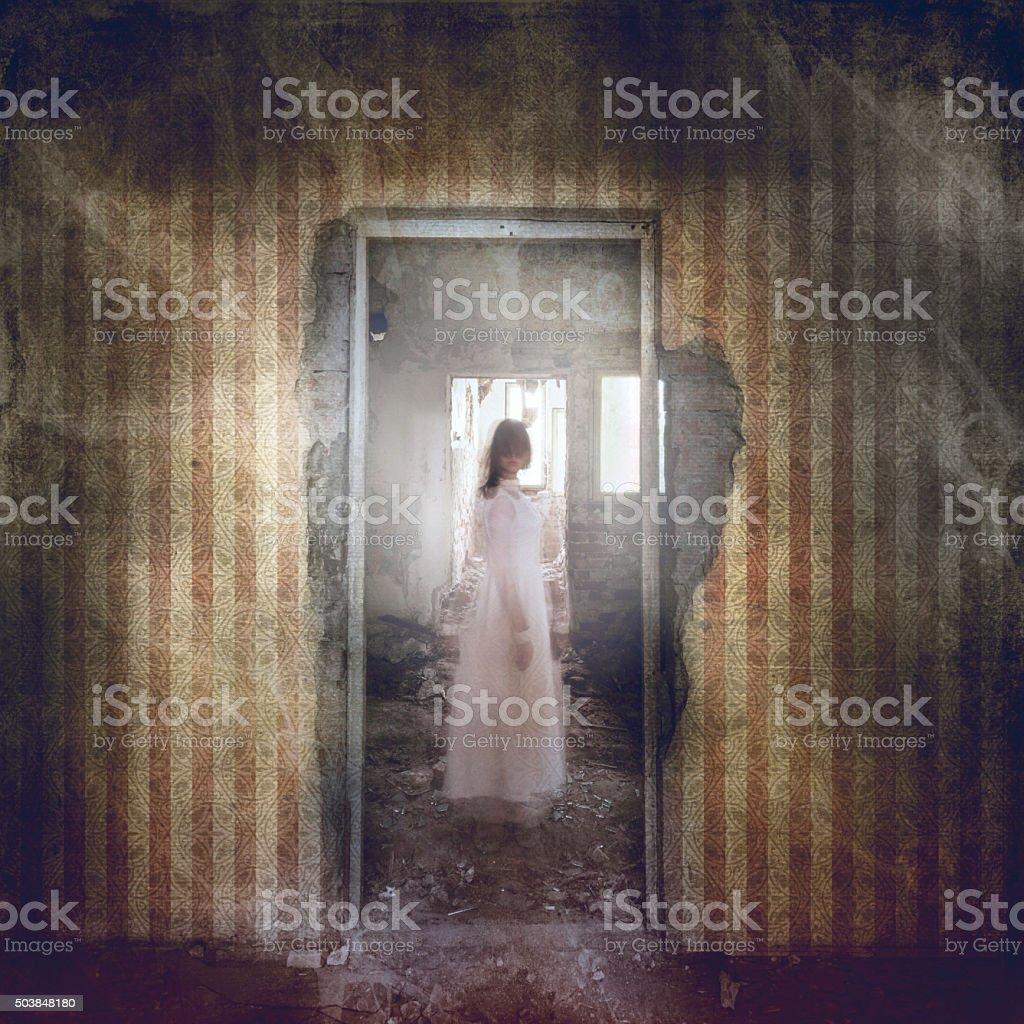 Spooky girl appears in white dress stock photo
