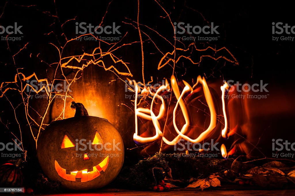 Spooky halloween pumpkin background with light draw BOO royalty-free stock photo