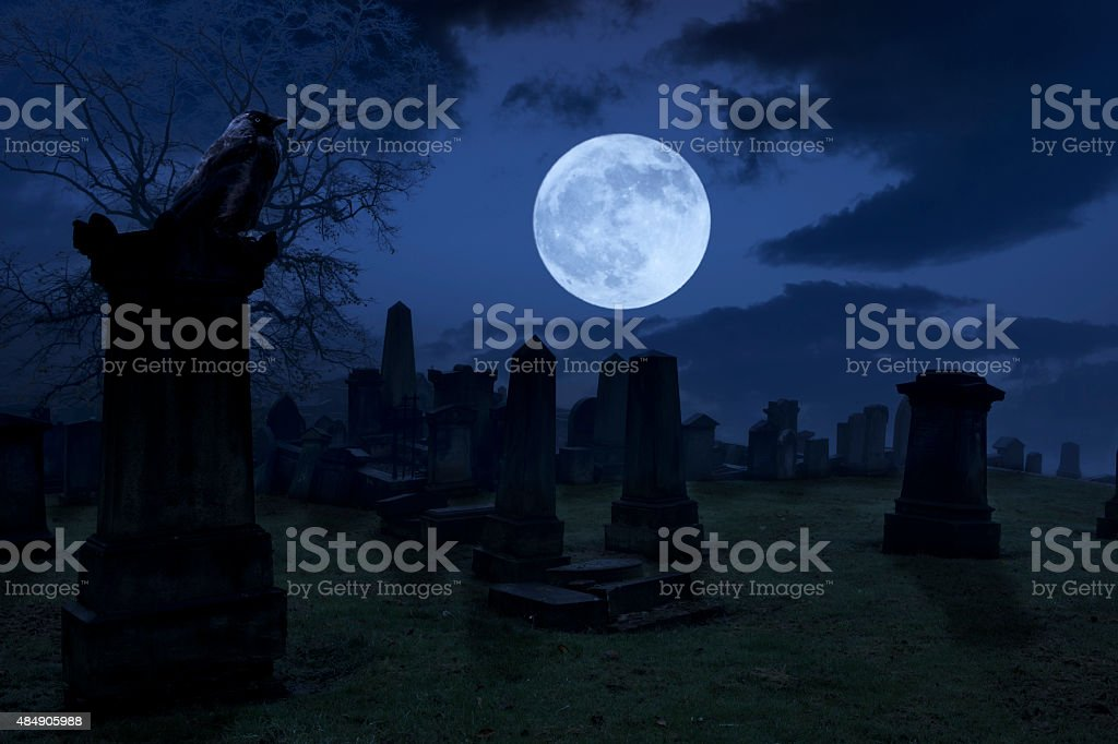 Spooky night at cemetery stock photo