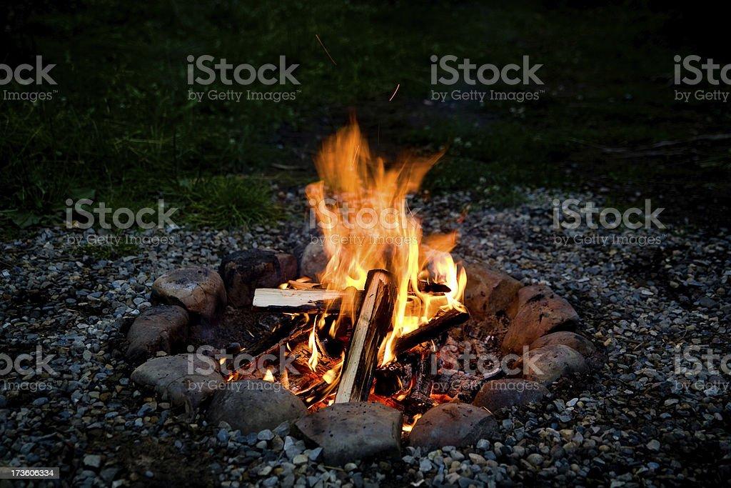 Spooky orange campfire at night stock photo