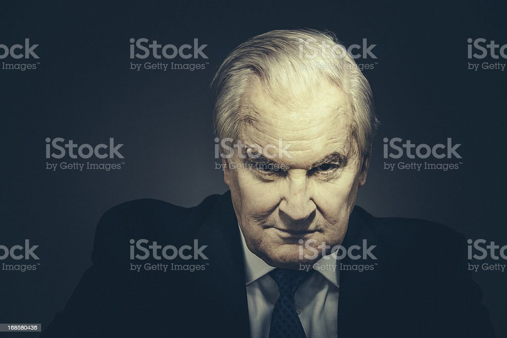 spooky senior businessman stock photo