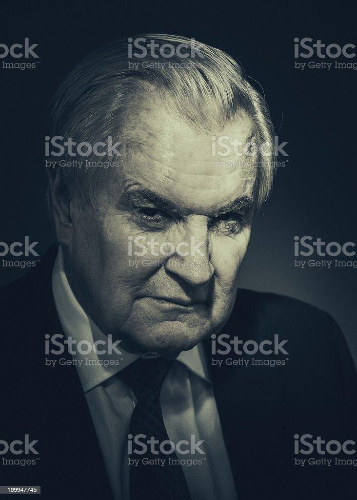 spooky senior businessman stock photo