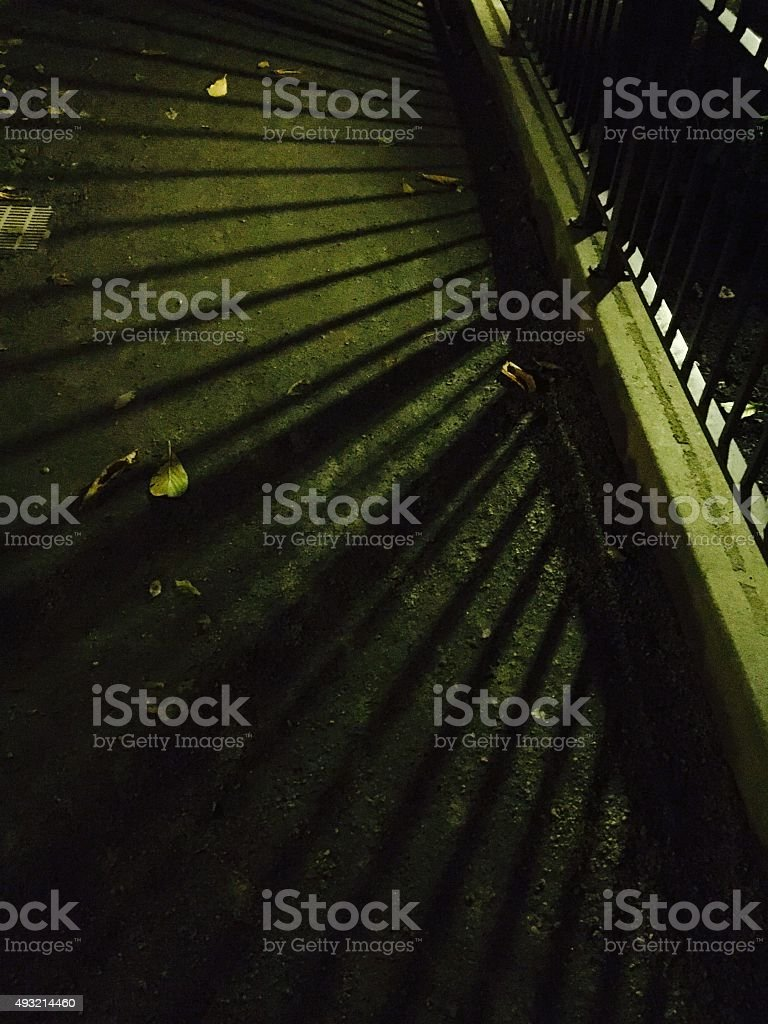 Spooky shadows of a fence at night royalty-free stock photo