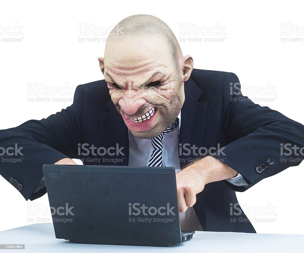 spooky thief on computer in business outfit royalty-free stock photo