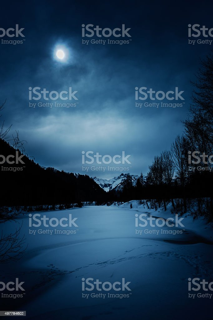 spooky winter landscape at night stock photo