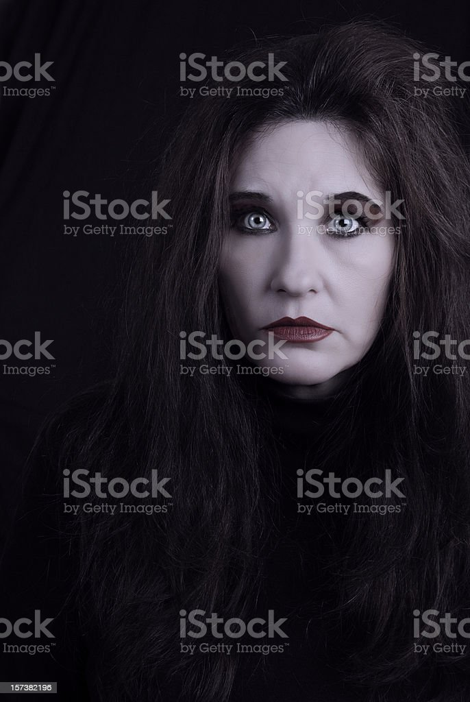 Spooky Woman (Or Ghost) Looks Mesmerized stock photo