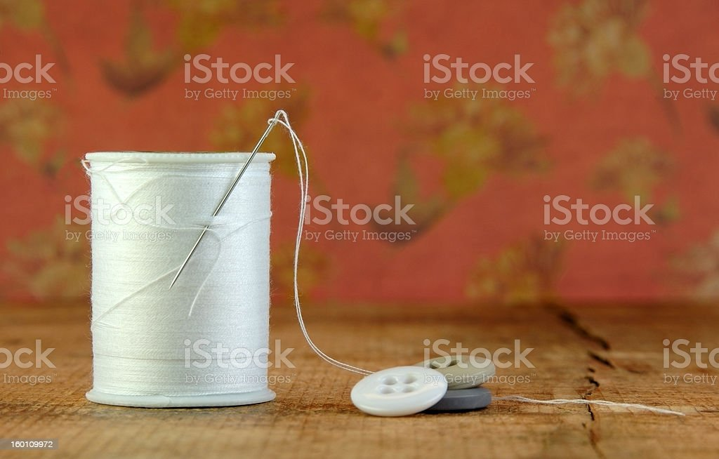 Spool of Blue Thread with Needle and Buttons royalty-free stock photo