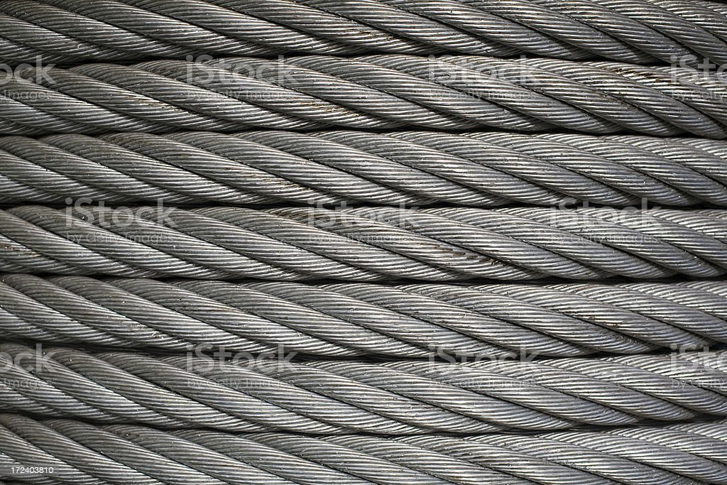 Spool of dirty metal industrial cable royalty-free stock photo
