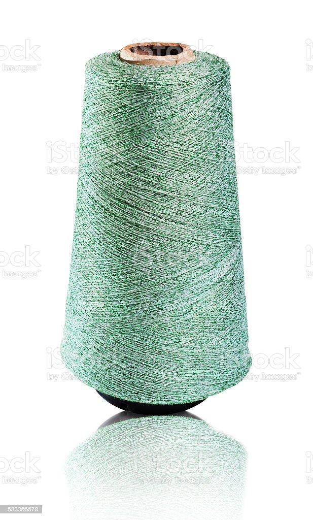 Spool of green shiny thread. stock photo