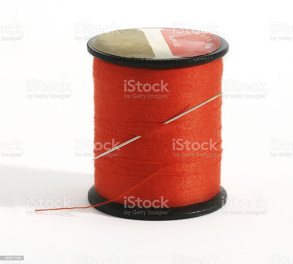 Spool of red thead with needle.  Macro. royalty-free stock photo