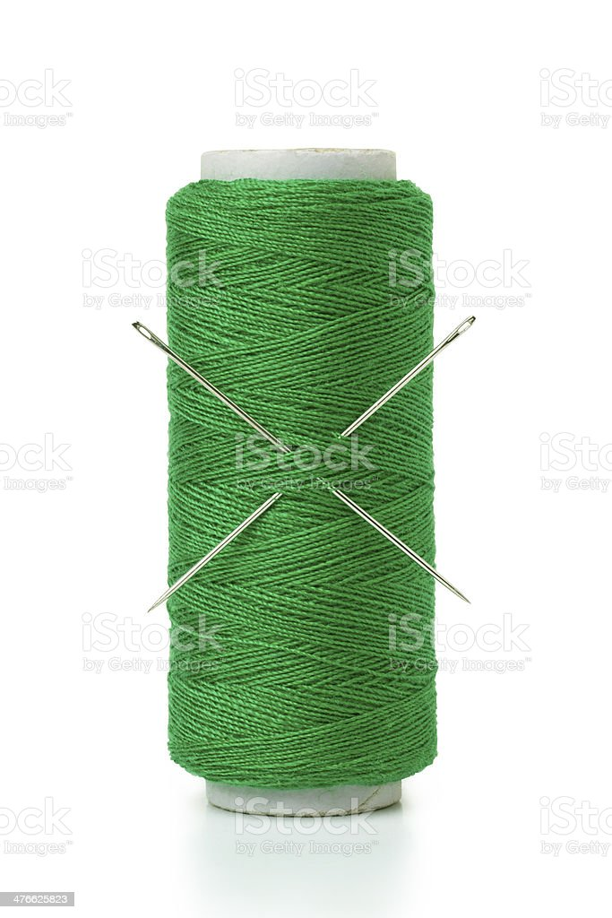 Spool of thread and needle royalty-free stock photo