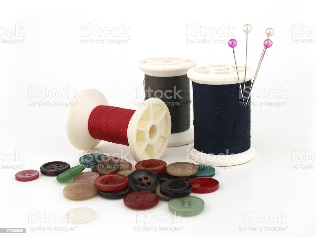 spool of thread, needle and button stock photo