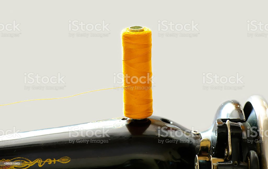spool of thread on the machine royalty-free stock photo