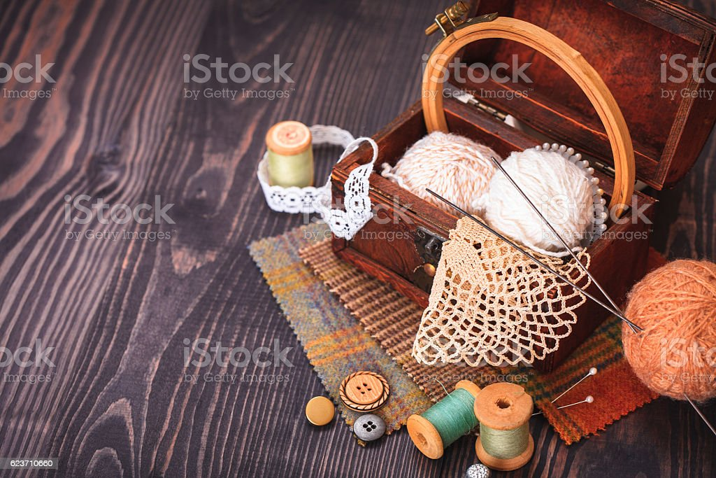 Spool of thread, thimble and a box with needlework stock photo