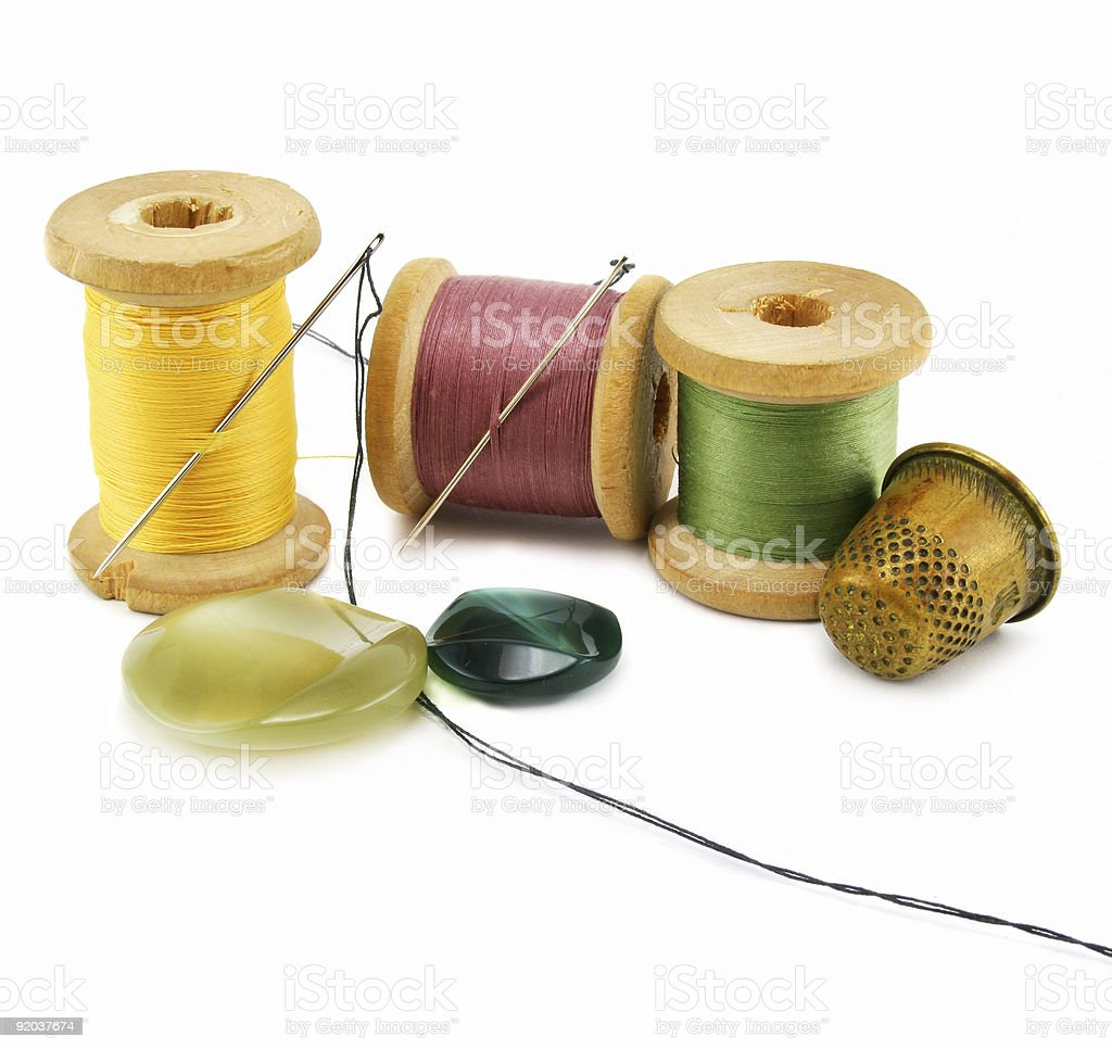 Spool of thread, thimble and needle royalty-free stock photo
