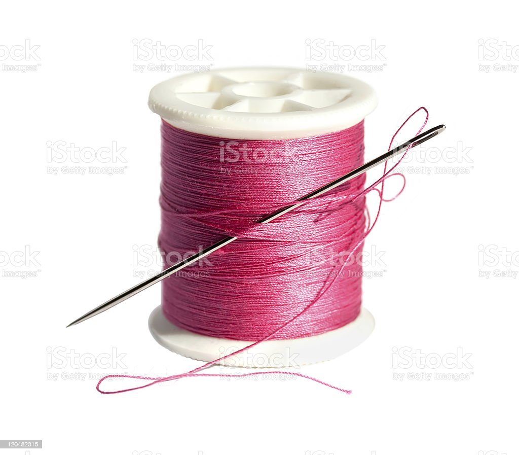 Spool of thread with a needle royalty-free stock photo