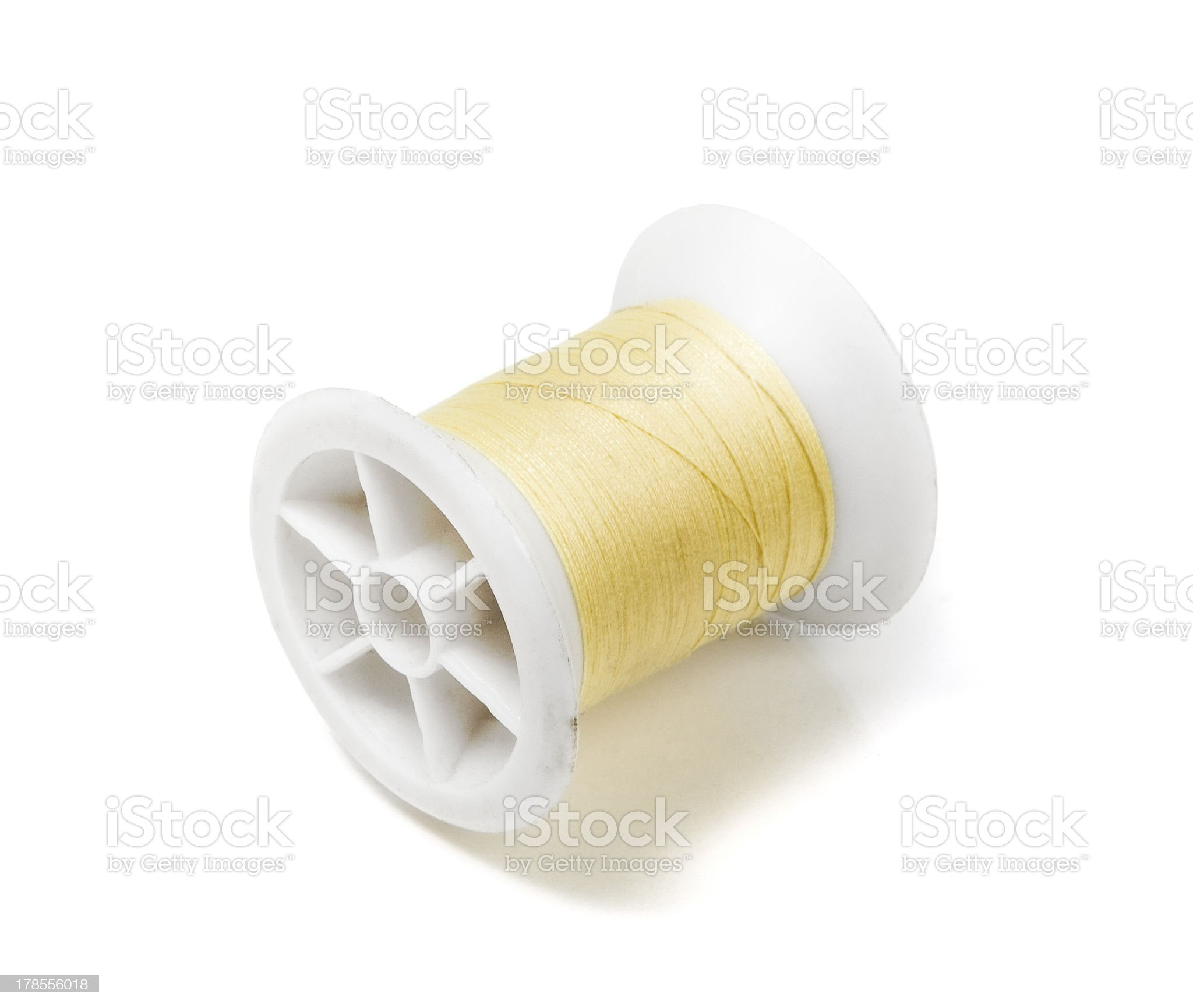 Spool of Yellow Thread royalty-free stock photo