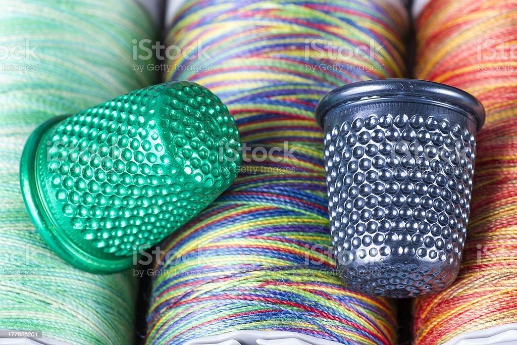 Spools and Metallic Thimbles. Colored Texture Macro. royalty-free stock photo