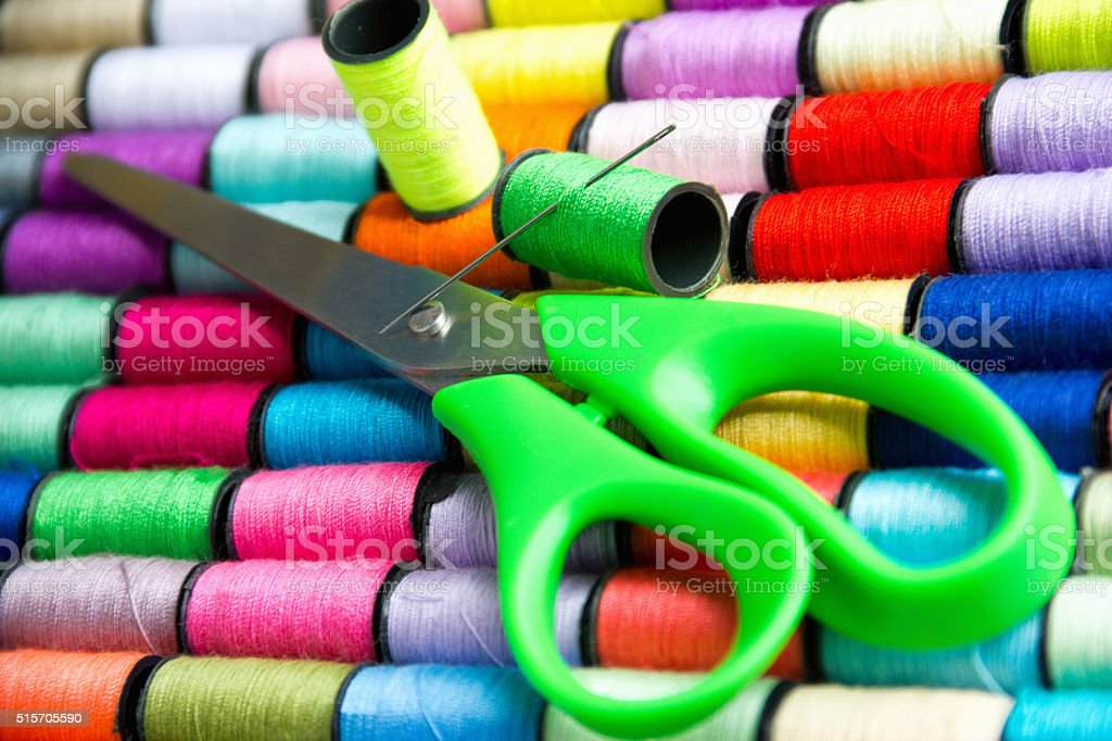spools of colored thread and scissors stock photo