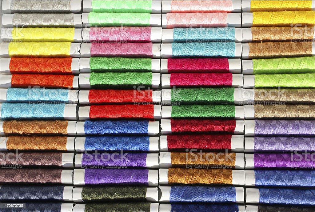 spools of colored thread stock photo