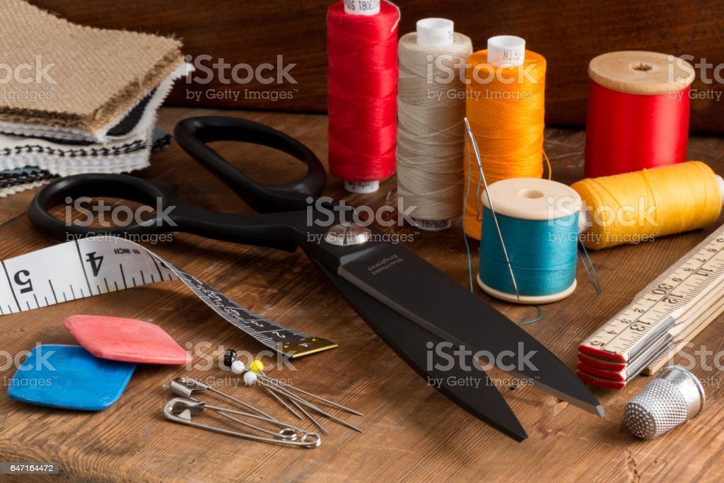 Spools of Different Color Thread and Sewing Kit stock photo