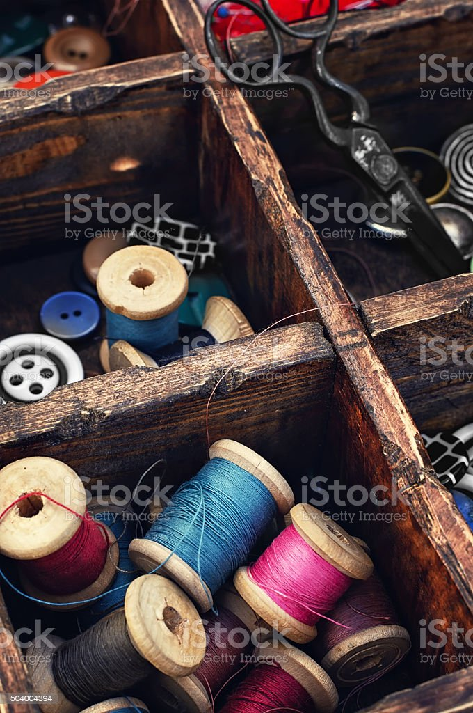 Spools of thread and buttons stock photo