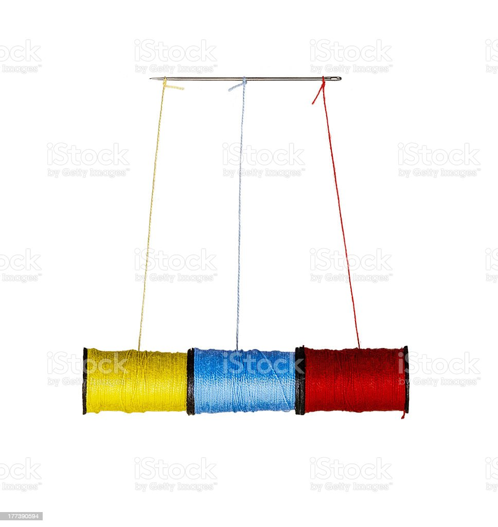 Spools of Thread Hanging From Needle stock photo