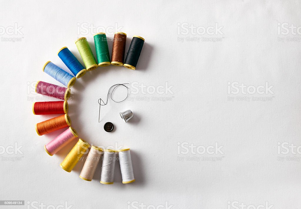 spools of thread in semicircle stock photo
