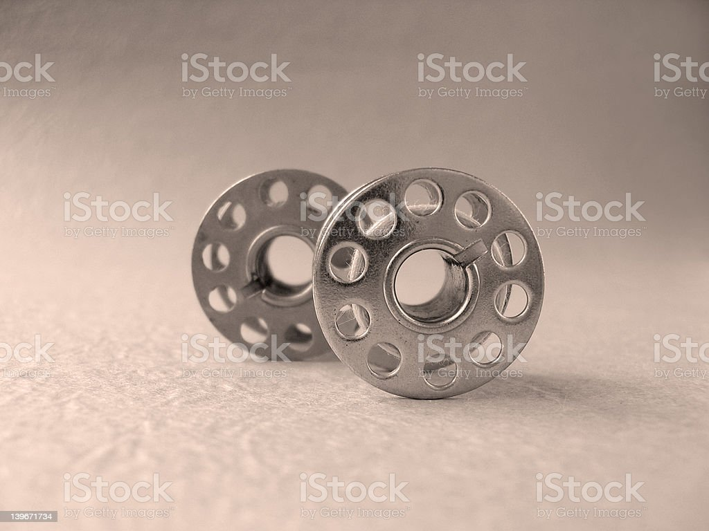 spools used at old sewing machine royalty-free stock photo