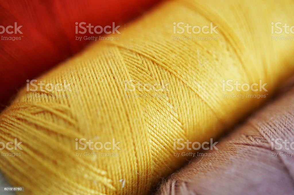 Spools with colorful threads used for sewing stock photo